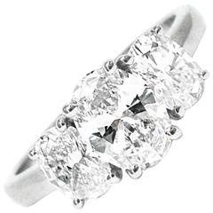 0.70 Carat GIA Cert Oval Cut Diamond Platinum Three Stone Ring