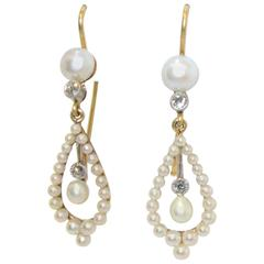 Edwardian Natural Pearl Diamond Gold Platinum Earrings