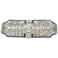 Art Deco Black Enamel 8.00 Carats Diamonds Platinum Filigree Brooch