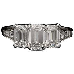 Hancocks Elegant Emerald-Cut Diamond  Three Stone Platinum Ring