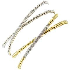 White and  Yellow Gold Criss Cross Bangle Bracelets