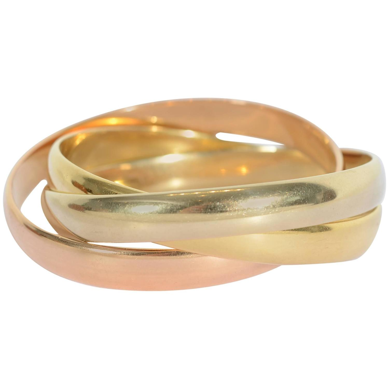 Heavy Weight Cartier Trinity Gold Bangle Bracelets at 1stdibs