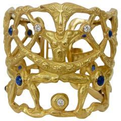 Sapphire Diamond and Gold Tribal Motif Cuff Bracelet Circa 1960