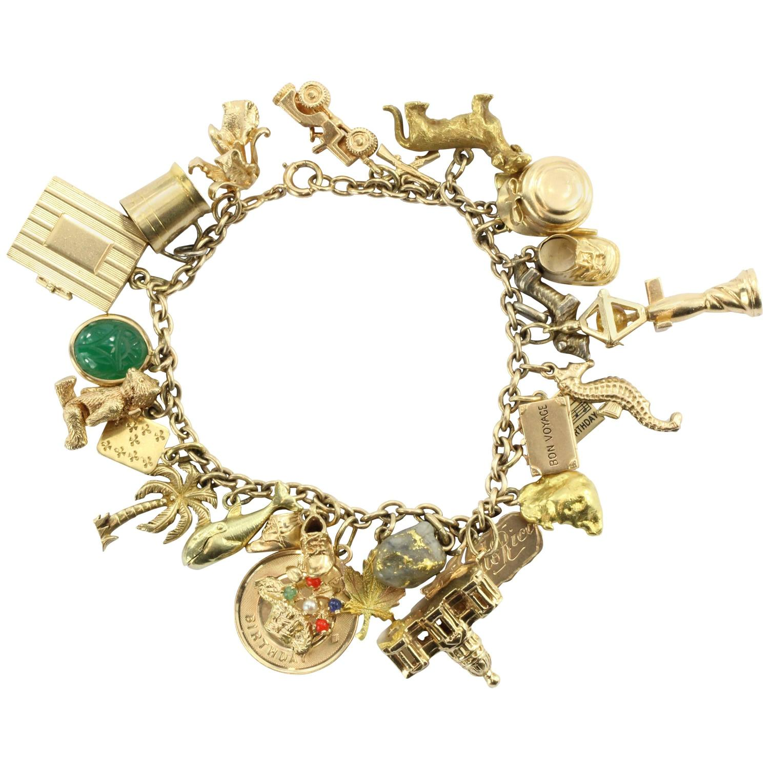 1940s Gold Charm Bracelet with Cartier and Tiffany and Co Charms
