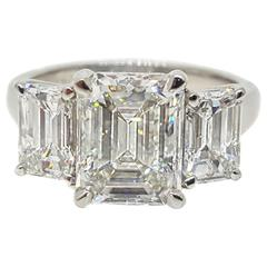Rectangular 4.64 Carats Emerald Cut Three Stone Platinum Ring