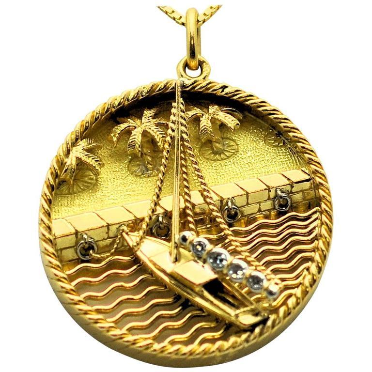 gubelin gold sailboat and pendant charm at
