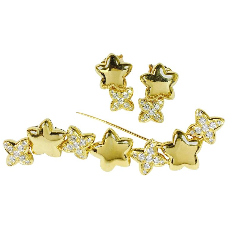 Van Cleef & Arpels Stars Diamond Gold Earrings and Brooch 1