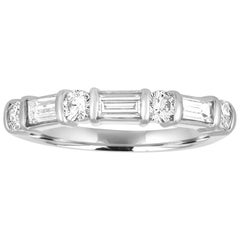0.75 Carats Round And Baguette Diamond Half Band Platinum Ring