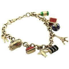 Gold Rolo Link Charm Bracelet with Nine Enamel Travel Charms