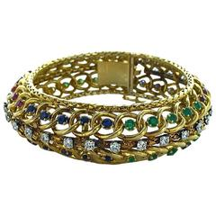 1960s Jacques Lacloche Diamond Emerald Sapphire Ruby Gold Bracelet
