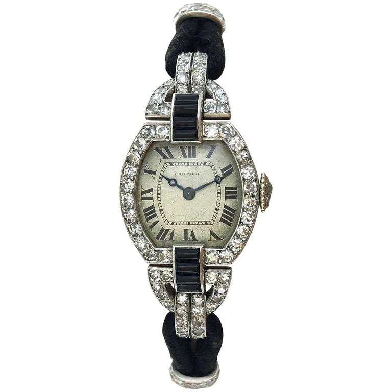 Art Deco testimony by Cartier. This wristwatch is totally complete and in authentic condition.  Platinum, Yellow Gold 18k 750 (Black enameled), Diamond (Old mine cut and Rose-cut) and Onyx Wristwatch.  Roman numerals.  Three serial numbers on the