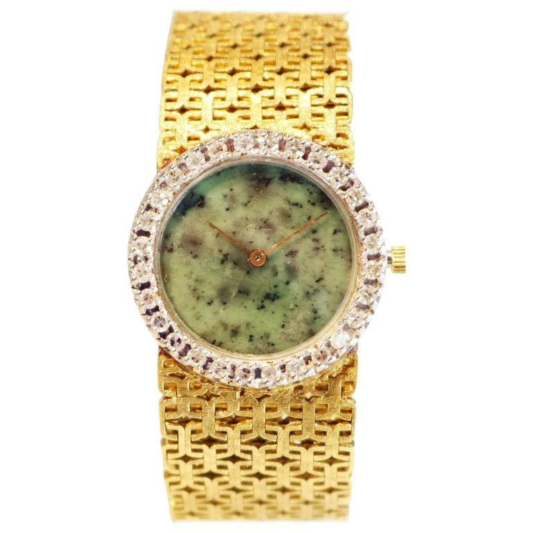 1970's Ebel Watch with Jade Dial and Diamond Bezel on a gold bracelet. For Sale
