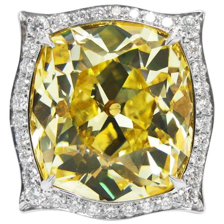 14.46 Carat GIA Fancy Intense Yellow Old Mine Cut Diamond and Platinum Ring
