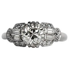 Art Deco Platinum 1.10 Carat Diamond with Antique Cut Diamonds, circa 1910