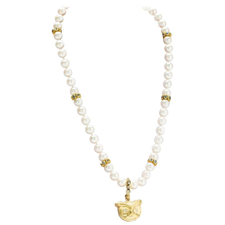 gold owl pendant  Pearl necklace with sapphire spacers