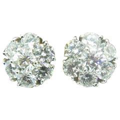 VAN CLEEF & ARPELS Diamond Fleurette Earrings.