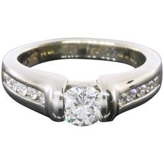 Sleek White Gold 1 Carat Round Diamond Classic Channel Set Engagement Ring