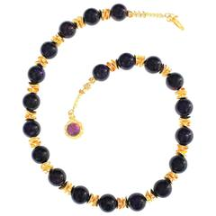 Necklace of Polished Amethyst Spheres Accented with Gold tone Flutters