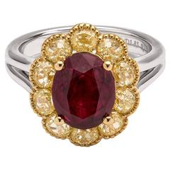 Stunning Burma oval ruby with fancy yellow diamonds