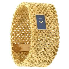 A Lady's Yellow Gold Wide Basket Weave Bracelet Watch by Piaget