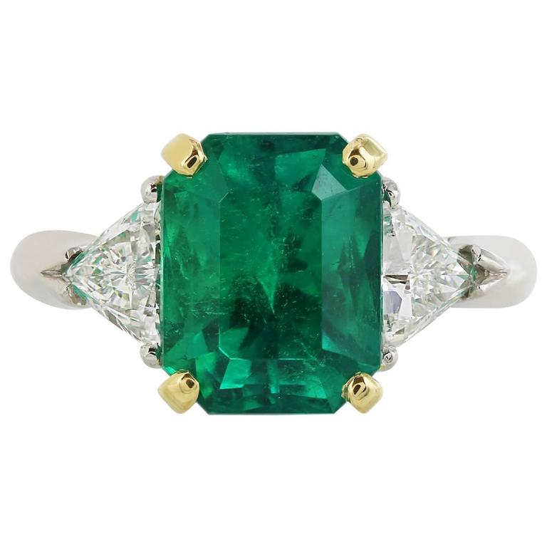 3.54 Carat Emerald .77 Carat Diamonds Platinum Three-Stone Ring