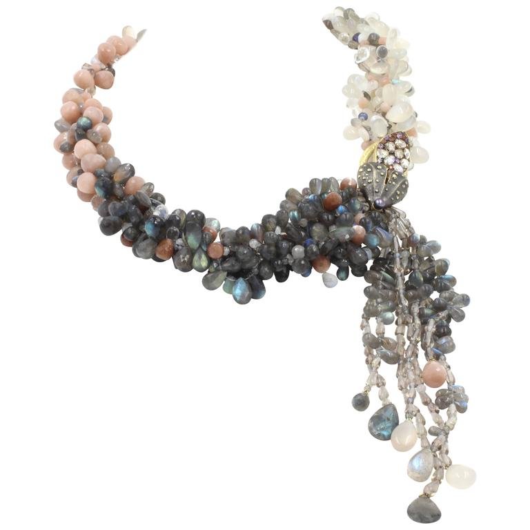 """The magnificent """"Signature"""" necklace features labradorite, moonstone, sunstone, tanzanite, and quartz beads that are both smooth and faceted. The 18K yellow gold clasp is plated with rhodium (a member of the platinum group) then set with"""