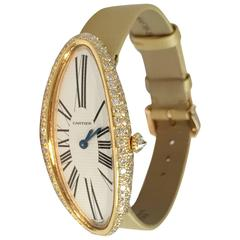 Yellow gold and diamonds Baignoire Cartier watch.