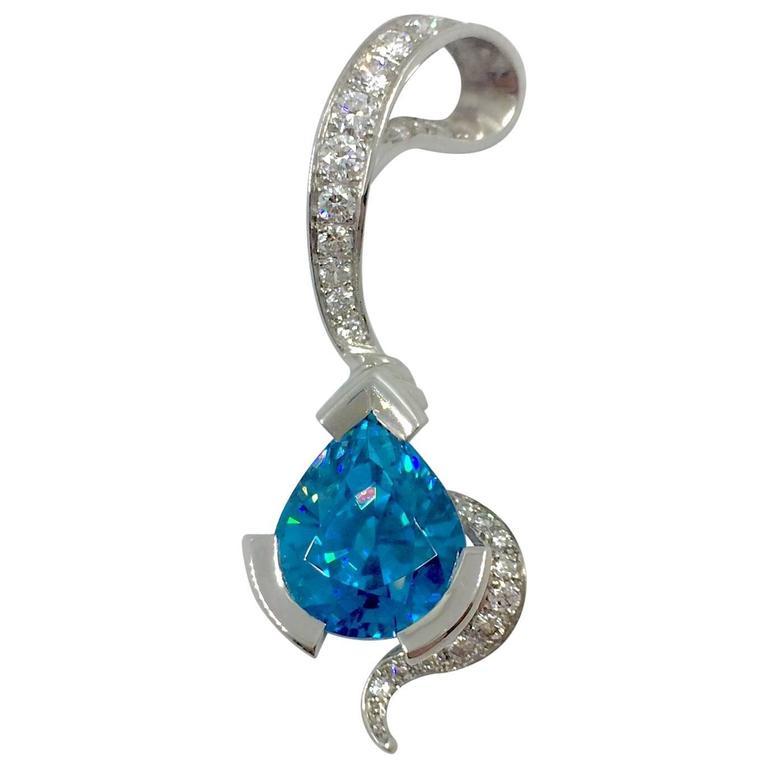 G. Minner 8.66 Carat Intense Blue Zircon Diamond Gold Pendant