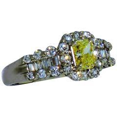 0.60 Carat Light Fancy Yellow Diamond Platinum Engagement Ring