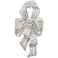 1930s Diamond Platinum Naturalistic Bow Pin