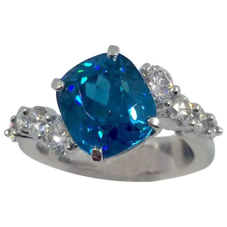 G. Minner 5.85 Carat Blue Zircon Diamond Gold Ring
