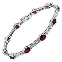 6.28 Carat Oval Rubies Diamonds Gold Bracelet