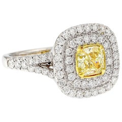 GIA Certified Fancy Intense Yellow Diamond 18 Karat White Gold Halo Ring