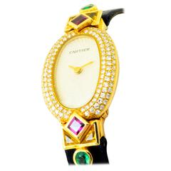 Ladies Cartier Wrist Watch Set With Yellow Gold Emeralds Sapphires Diamonds Ruby