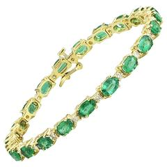 Oval Emerald and Diamond Patterned Gold Tennis Bracelet