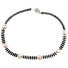 Stunning elegance of Black Onyx and peachy Pearls necklace