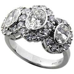 HRD Cert 0.80 Carat Two 0.68 Carat Oval Cut Diamond 1950's Three Stone Ring