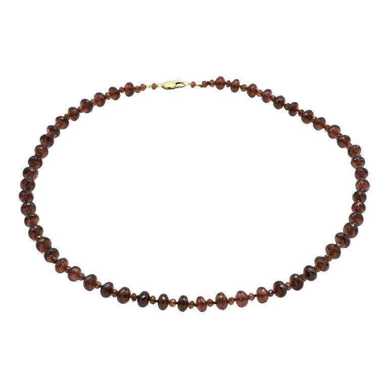 faceted garnet bead necklace in gold with two sizes of