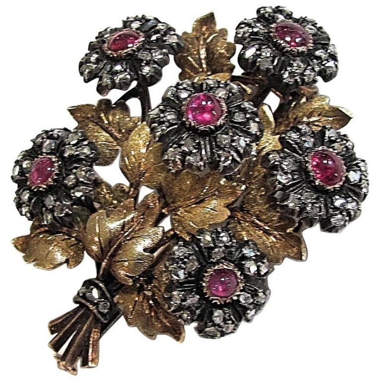 1940s Mario Buccellati ruby diamond silver gold floral brooch