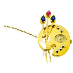 Diamond Sapphire and Ruby Gold Bucherer Clock Brooch