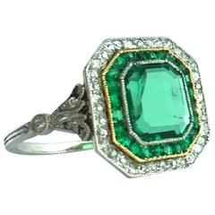 1930s Art Deco Emerald Diamond Gold Platinum Ring