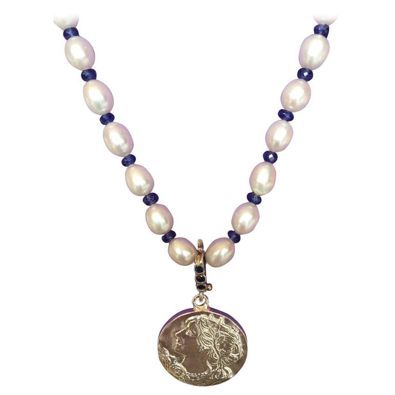 Sterling Silver Lady with her City Crown Pendant on Pearl Sapphire Necklace