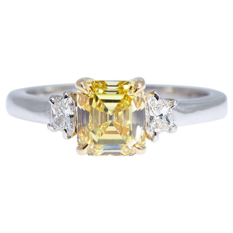 GIA Intense Yellow 1 62 Carats Emerald Cut Diamond Platinum Three Stone Ring