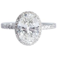 GIA Certified 3.01 Carats Oval Diamond Platinum Halo Engagement Ring
