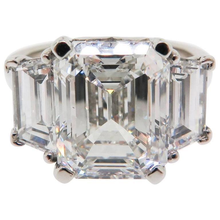 GIA Certified 5.47 carats Emerald Cut Diamond and Trapezoids Platinum Ring