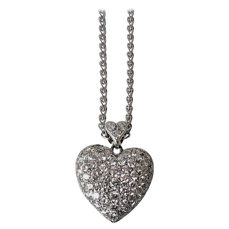 Diamond Gold Double Heart Pendant Suspended From Gold Chain