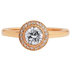 Captivating Round Brilliant Cut Diamond Gold Engagement Ring