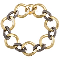 Fred Paris Gold and Gun Metal Oval Link Bracelet