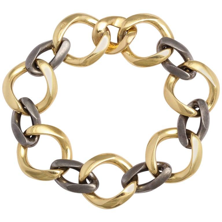 Fred Paris Gold and Gun Metal Oval Link Bracelet