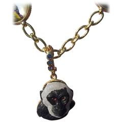 Monkey Pendant in Gold Bezel on a Sapphire Bail
